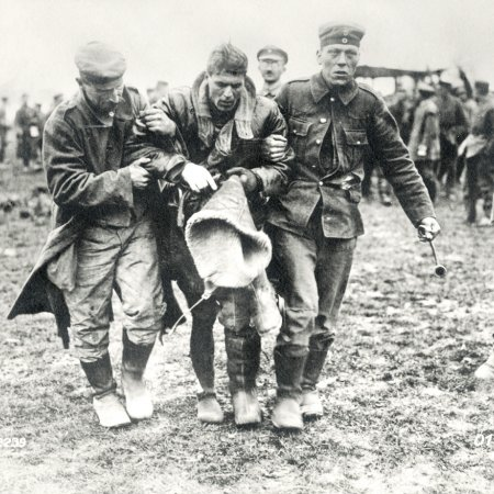 017 German Troops Helping Wounded British Pilot