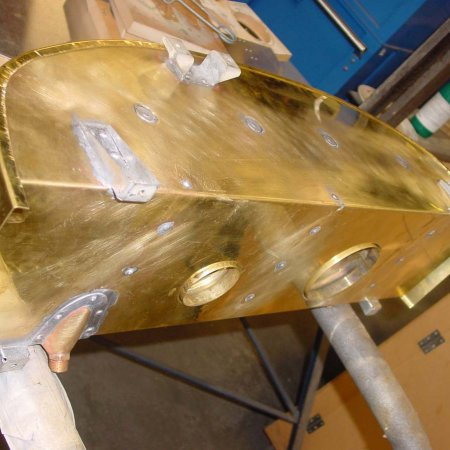 Test Fitting Top Section Of Emergency Fuel Tank Skin