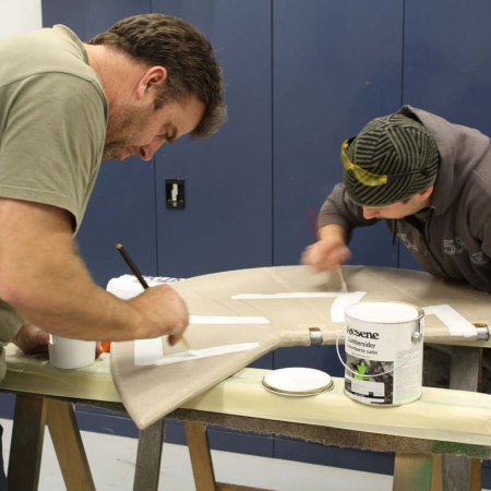 Olly And Paul Painting Iron Cross On Rudder